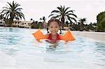 Girl (5-6 years) in swimming pool, portrait