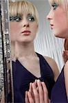 Portrait of teenage girl (16-17) looking in mirror