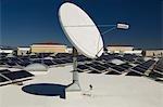 Satellite Dish with Solar Panels at Solar Power Plant