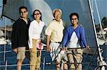 Family on sailboat, (portrait)