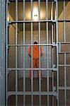 Prisonnier dans une cellule de prison