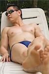 Man Sunbathing on Lounge Chair