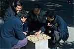 China,Beijing. Men playing Chinese Chess in a local neighbourhood Hutong.