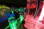 China,Beijing,Longqing Gorge Tourist Park. Ice sculpture festival - a girl's face looking through an ice sculpture illumination .