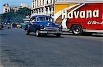 Classic car and Havana Rum truck in Havana Viejo,Old Havana World Heritage Area,Cuba
