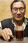 A jeweller in Khan el-Khalili enjoys a cup of tea and a cigarette,Cairo,Egypt