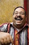 A jeweller in Khan el-Khalili enjoys a joke,Cairo,Egypt