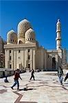 Childern play football in front of the Abu Al-Abbas Al-Mursi Mosque,Alexandria,Egypt