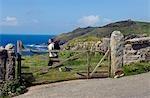 A walker sets off along the coastal path around Cape Cornwall on the north Cornish coast,England