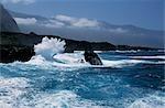 The sea beats against the black volcanic sea cliffs at Las Puntas on the El Golfo coast