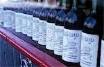 Wine bottles lined up in a shop window