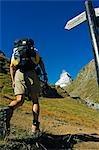 A Matterhorn (4477m) hiker at the trail junction,Zermatt,Valais,Switzerland