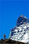 Switzerland The Valais Zermatt Alpine Resort The Matterhorn (4477m) Hiker on Trail below the Matterhorns Peak