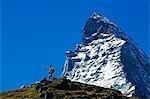 The Matterhorn (4477m). Hiker on rrail below the Matterhorn's peak