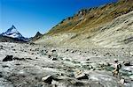 The Matterhorn (4477m). Hiker crossing Monte Rosa glacier,Zermatt,Valais,Switzerland