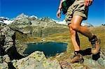 Hiker on trail above lake at Schwarzee Paradise,Zermatt,Valais,Switzerland