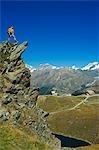 Hiker high on trail above lake at Schwarzee Paradise,Zermatt,Valais,Switzerland