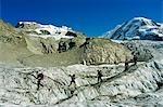 Hikers crossing crevasses on the Monte Rosa glacier,Zermatt,Valais,Switzerland