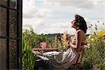 woman on balcony drinking tea