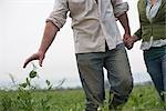 farming couple walking in field