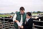 business woman advising farmer