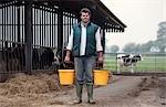 farmer with buckets