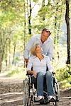 Man pushes woman in a wheelchair
