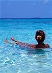 Woman relaxing in the water,Maldive Islands. Indian Ocean. .