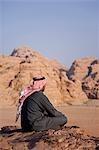 A local bedouin man looks out over Wadi Rum,Jordan .