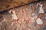 Hervorragende Felsmalerei in der Jebel Acacus in der libyschen Sahara Frauen, Strauße, Vieh und Blumen.