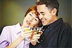 Senior couple clinking glasses of white wine