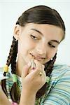 Girl putting on make-up, portrait