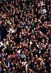 Crowd sitting in stadium, blurred.