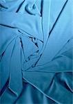 Folded blue fabric, close-up, full frame