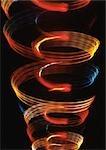 """""""""""Spirale"""""""" effet de lumière, un dans l'autre, oranges, rouges et bleus."""