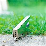 Stapler at edge of sidewalk