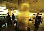 Business people walking in airport terminal.