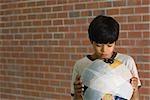 Boy holding bandaged globe, front view