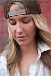 Close-up Portrait of Woman wearing Baseball Hat