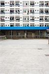 Apartment building facade, woman washing windows
