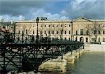 France, Paris, Pont des Arts and the Louvre