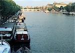 France, Paris, barges docked on River Seine