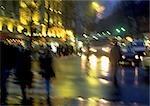 France, Paris, street scene at night, blurred