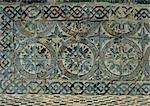 Tile mosaic with floral motif, close-up
