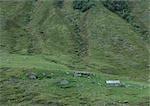 Log cabins on mountainside