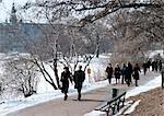 Sweden, Stockholm, people walking in park in snow