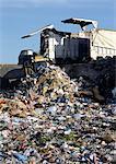 Truck dumping trash in landfill