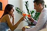 Couple toasting with orange wine