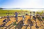 boy on exercise bike next to beach