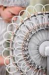 Close up of a man operating machinery